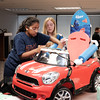 072916  Wesley Bunnell | Staff<br /> <br /> Children with disabilities, and their families, were presented with modified toy cars by middle school through college age technology students on Friday July 29th at the CCSU  ITDB building.