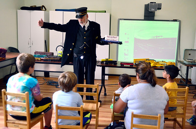 7/29/2016 Mike Orazzi | Staff Railroad Museum of New England's Dave Page talks about the various trains while at the Imagine Nation Museum Early Learning Center Friday morning.
