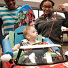 072916  Wesley Bunnell | Staff<br /> <br /> Michael Ramsdell, age 13 months, gets ready to take his new electric car for a drive. Children with disabilities, and their families, were presented with modified toy cars by middle school through college age technology students on Friday July 29th at the CCSU  ITDB building.