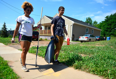 7/30/2016 Mike Orazzi | Staff Ashley Davis and Daniel Pobidel while cleaning up on Willow Street in New Britain Saturday morning as part of North Oak NRZ 2nd Community Cleanup.
