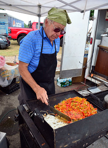 7/30/2016 Mike Orazzi | Staff  John Arrigone works the grill at the 3 Chicks stand during the 12th annual Italian American Festival on lower Center Street in downtown Southington Saturday afternoon.