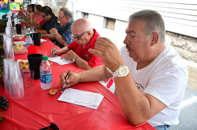 7/30/2016 Mike Orazzi | Staff  Gerry Triano while judging the wine contest during the 12th annual Italian American Festival on lower Center Street in downtown Southington Saturday afternoon.