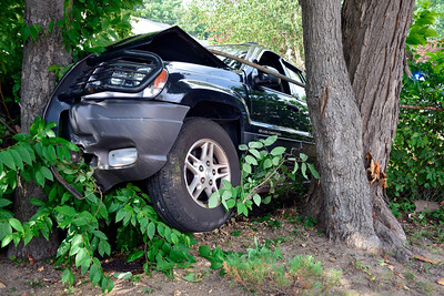 7/30/2016 Mike Orazzi | Staff  A Jeep Grand Cherokee after a one vehicle crash on Peck Lane in Bristol Saturday afternoon. The driver was treated by medical personnel.