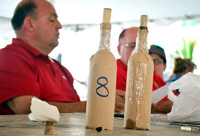 7/30/2016 Mike Orazzi | Staff  Some of the different wines during the wine contest at the 12th annual Italian American Festival on lower Center Street in downtown Southington Saturday afternoon.