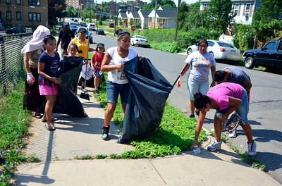 7/30/2016 Mike Orazzi | Staff Jaritza Villa holds a large garbage bag during a clean up of the North Oak Neighborhood in New Britain Saturday morning as part of North Oak NRZ 2nd Community Cleanup.