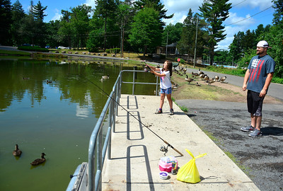 7/5/2016 Mike Orazzi | Staff Bill Vannostrand and his daughter Lillian,7, while fishing at Page Park Tuesday afternoon.   *** stand alone ***