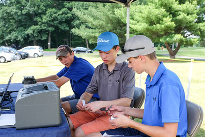 070616  Wesley Bunnell | Staff  Stanley Golf Course is holding the PGA CT Section Jr. Golf Tournament on Wednesday & Thursday.  Josh Houle of Newtown , furthest, looks on as Jason Hsieh of Southport , middle, & T.J. Shaw of Farmington go over their scores.