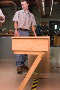 070716  Wesley Bunnell | Staff  Aaron Boutin , age 17, a rising senior at E.C. Goodwin placed 1st in CT in carpentry competition and represented CT on the national level placing 9th. Shown is a writing desk he built during the national competition.