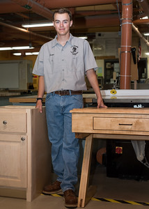 070716  Wesley Bunnell | Staff  Aaron Boutin , age 17, a rising senior at E.C. Goodwin placed 1st in CT in carpentry competition and represented CT on the national level placing 9th.  Aaron is shown with a cabinet which he built on the left to win the CT competition.  The writing desk on the right was built during the national competition.