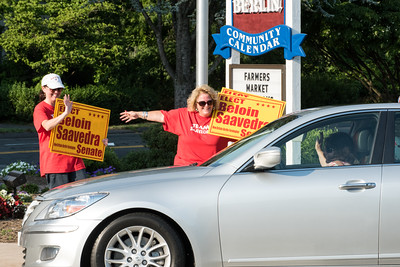 070616  Wesley Bunnell | Staff  Candidate for State Senator Sharon Beloin-Saavedra waived and held up signs to travelers in front of CVS in Berlin on Wednesday afternoon with the help of several volunteers.  Andrea Foligno, right, points to Sharon Beloin-Saavedra as she waives to a car that stopped briefly to give words of encouragement.