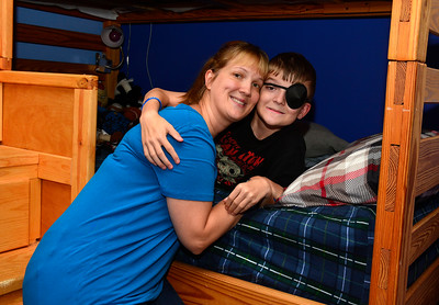 7/7/2016 Mike Orazzi | Staff Stacy Blake with  her 11-year-old son Matthew, had been blind in his left eye (bilateral dislocated lenses and also learned he had Marfan's Syndrome) and recently woke up after a corrective surgery and found that he could see again.