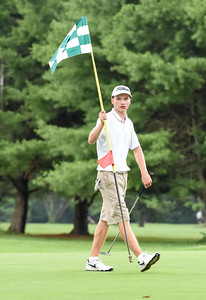 070716  Wesley Bunnell | Staff  Stanley Golf Course held day two of the PGA CT Section Jr. Golf Tournament on Thursday. Jack Snyder, age 17, of Ellington pulls the flag on the 9th green.