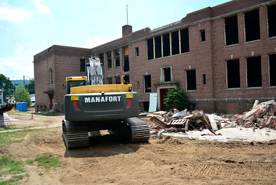 7/7/2016 Mike Orazzi | Staff Demolition work on the Old Linden Street School in Plainville Thursday.