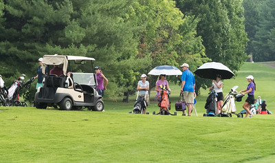 070716  Wesley Bunnell | Staff  Stanley Golf Course held day two of the PGA CT Section Jr. Golf Tournament on Thursday. Golfers wait on the fairway for news on play being delayed due to rain.