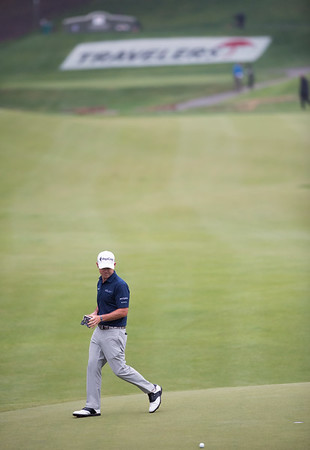 06/23/18 Wesley Bunnell | Staff Brian Harman who is tied for 3rd at -11 examines his putt on the 16th hole The Travelers Championship on Saturday June 23.