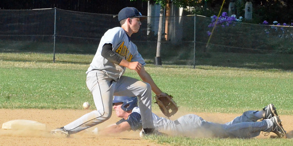 KYLE MENNIG - ONEIDA DAILY DISPATCH Sherrill Post's Mitch DeBarr (11) dives into second for a stolen base as the ball gets away from Adrean Post's Michael Zaino (9) during their American Legion Baseball District 5 playoff game in Sherrill on Sunday, July 17, 2016.