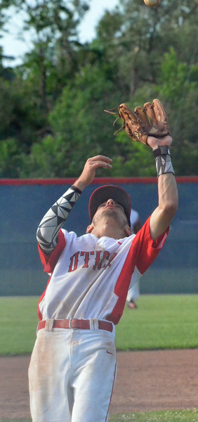 KYLE MENNIG - ONEIDA DAILY DISPATCH Utica Post's Brian Wojnas (15) catches the ball for the final out against Sherrill Post during their American Legion Baseball District 5 playoff elimination game in New Hartford on Monday, July 18, 2016.