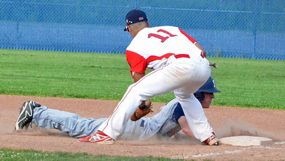 KYLE MENNIG - ONEIDA DAILY DISPATCH Sherrill Post's Mitch DeBarr (11) dives back into first under the tag of Utica Post's Chez Castronovo during their American Legion Baseball District 5 playoff elimination game in New Hartford on Monday, July 18, 2016.