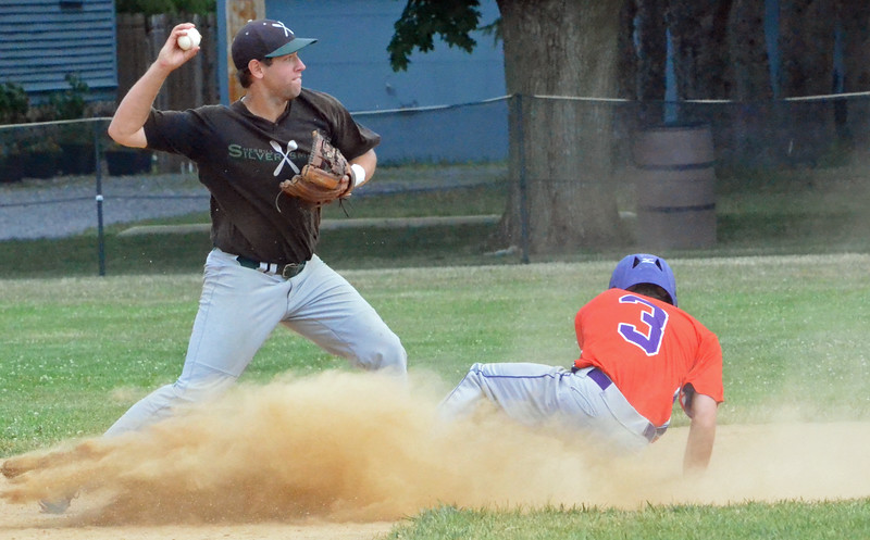 KYLE MENNIG - ONEIDA DAILY DISPATCH Sherrill Silversmiths second baseman Dylan Pounds avoids the slide of the Cortland Crush's Broderick Santilli and throws to first for a double play during their game in Sherrill on Wednesday, July 20, 2016.