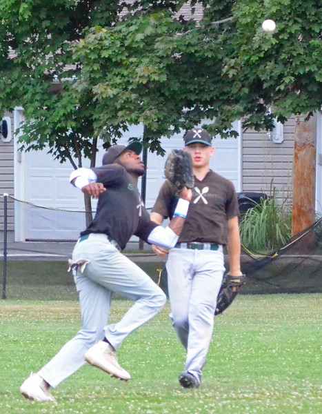 KYLE MENNIG - ONEIDA DAILY DISPATCH Sherrill Silversmith left fielder Michael Villa (7) makes a catch to retire a Cortland Crush batter as teammate Christian Aybar looks on during their game in Sherrill on Wednesday, July 20, 2016.