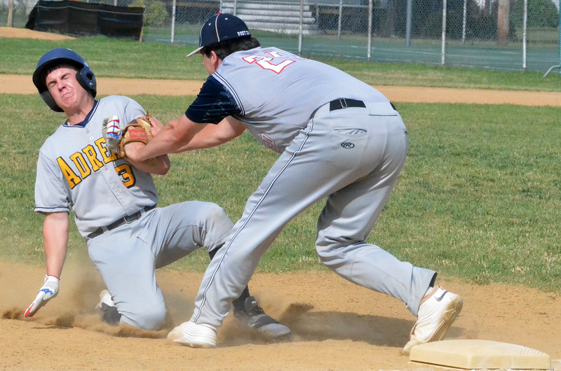 KYLE MENNIG - ONEIDA DAILY DISPATCH Sherrill Post's Andrew Roden (20) tags Adrean Post's Daniel Fitzgerald (3) during their American Legion Baseball District 5 playoff game in Sherrill on Sunday, July 17, 2016.