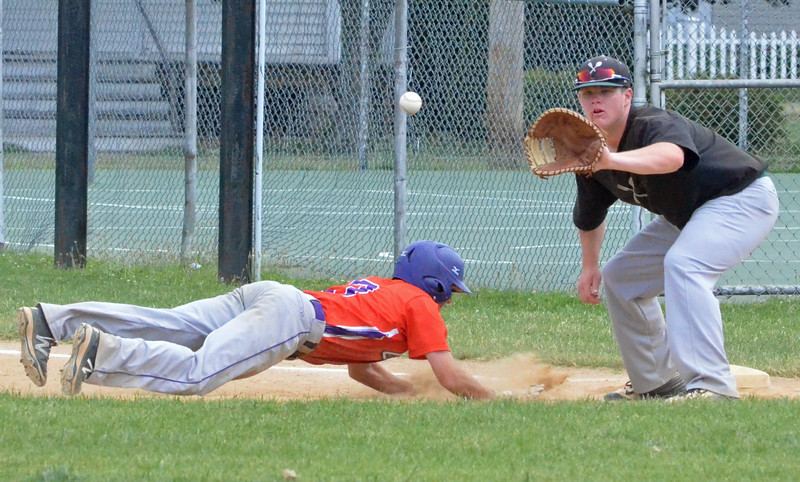 KYLE MENNIG - ONEIDA DAILY DISPATCH The Cortland Crush's Broderick Santilli (3) dives back into first as Sherrill Silversmiths first baseman Ryan McNamara (14) awaits a pickoff throw during their game in Sherrill on Wednesday, July 20, 2016.