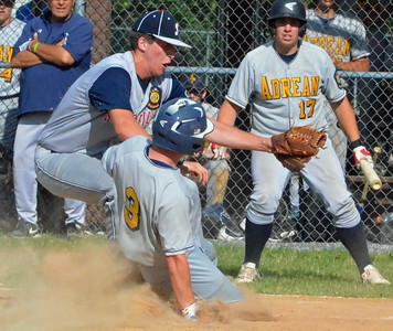 KYLE MENNIG - ONEIDA DAILY DISPATCH Adrean Post's Daniel Fitzgerald (3) slides safely into home under the tag of Sherrill Post's Jacob Purdy (31) during their American Legion Baseball District 5 playoff game in Sherrill on Sunday, July 17, 2016.