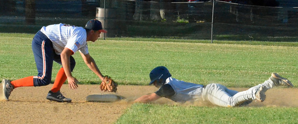 KYLE MENNIG - ONEIDA DAILY DISPATCH Sherrill Post's Ryan Palmer (9) dives into second under the tag of Smith Post's Zachary Cortese (18) for a double during the fifth inning of their American Legion Baseball game in Sherrill on Friday, July 15, 2016.