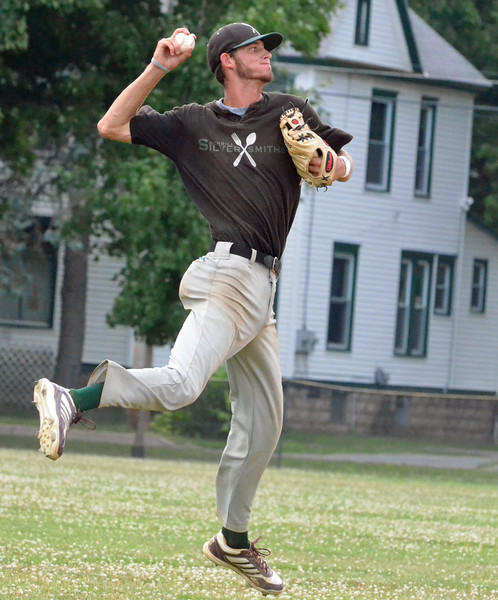 KYLE MENNIG - ONEIDA DAILY DISPATCH Sherrill Silversmiths shortstop Danny Crews jumps to make a throw to first to retire a Hornell Dodgers player during their NYCBL game in Sherrill on Wednesday, July 13, 2016.
