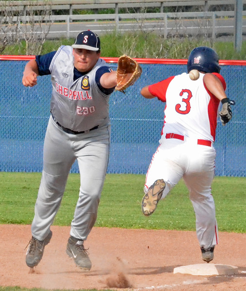 KYLE MENNIG - ONEIDA DAILY DISPATCH Utica Post's Nick Abraham (3) safely reaches first as the throw gets away from Sherrill Post's Ben Ziarko (25) during their American Legion Baseball District 5 playoff elimination game in New Hartford on Monday, July 18, 2016.