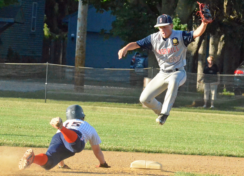 KYLE MENNIG - ONEIDA DAILY DISPATCH Smith Post's Ryan Samuels (15) dives back into second as Sherrill Post's Tyler Rotach (24) jumps to field a throw during their American Legion Baseball game in Sherrill on Friday, July 15, 2016.