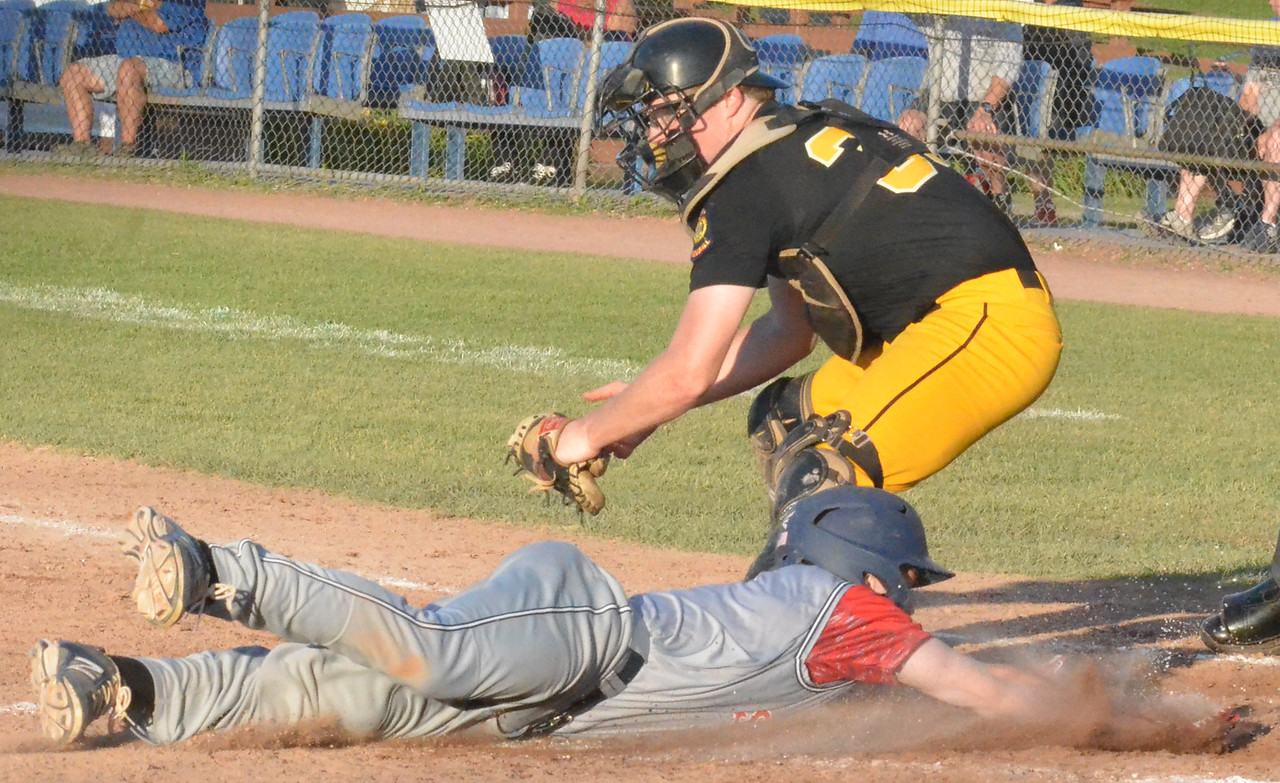 KYLE MENNIG – ONEIDA DAILY DISPATCH Sherrill Post's Zach Nell (7) dives safely into home, beating the tag of Rockland County catcher Stephen Greeley (39) during their American Legion Baseball State Championship tournament game in Utica on Friday, July 28, 2017.