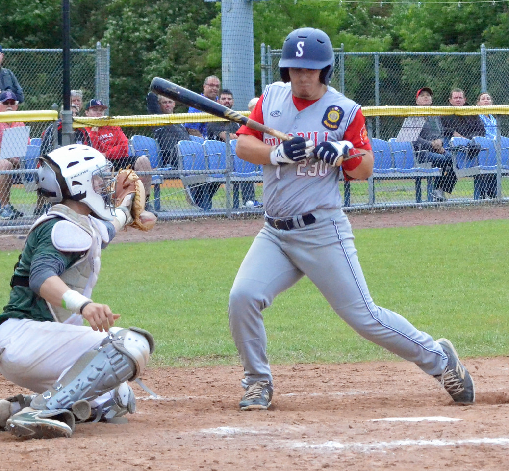 KYLE MENNIG – ONEIDA DAILY DISPATCH Sherrill Post's Dylan Shlotzhauer (1) is hit in the back by a pitch as Binghamton Post catcher Zach Pruden looks on during their American Legion Baseball State Championship tournament game in Utica on Tuesday, July 25, 2017.