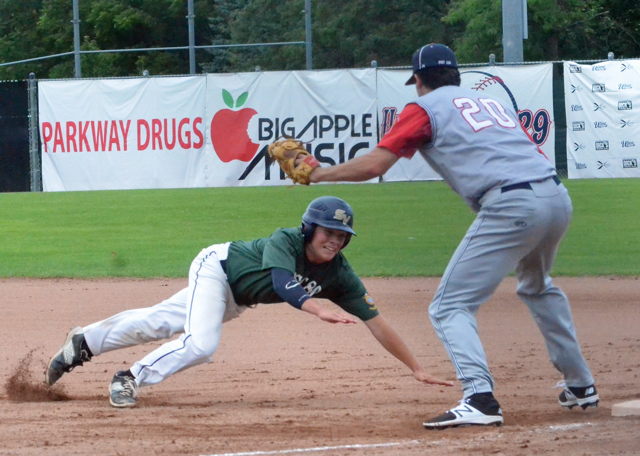 KYLE MENNIG – ONEIDA DAILY DISPATCH Binghamton Post's Samuel Chapman (14) dives back to first as Sherrill Post's Andrew Roden (20) reaches back to make the tag during their American Legion Baseball State Championship tournament game in Utica on Tuesday, July 25, 2017. Chapman was out on the play.