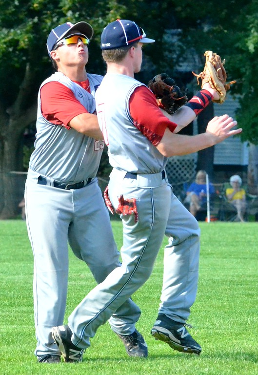 . KYLE MENNIG � ONEIDA DAILY DISPATCH Sherrill Post�s Zach Nell (7) collides with teammate Ryan Palmer (9) while making a catch to retire a Smith Post batter during their American Legion Baseball District 5 playoff game in Sherrill on Tuesday, July 18, 2017.