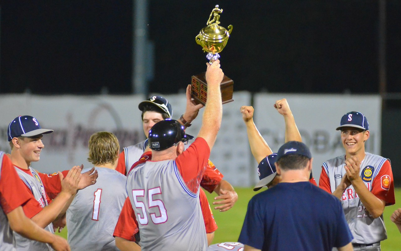 KYLE MENNIG – ONEIDA DAILY DISPATCH Sherrill Post coach John Roden holds up the trophy after his team won the American Legion Baseball District 5 championship in Utica on Friday, July 21, 2017.