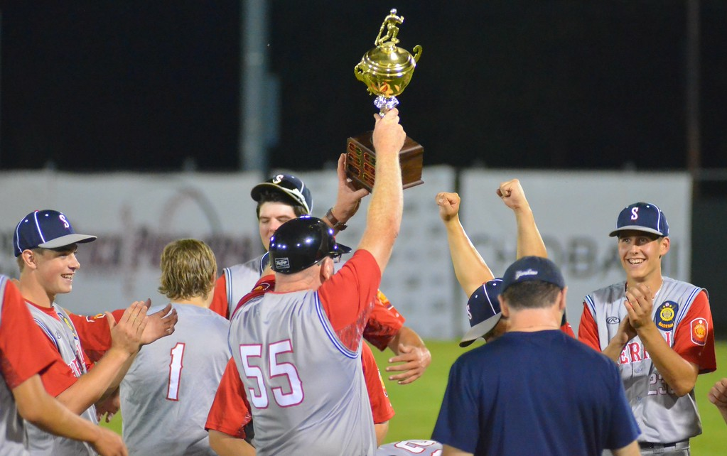 . KYLE MENNIG � ONEIDA DAILY DISPATCH Sherrill Post coach John Roden holds up the trophy after his team won the American Legion Baseball District 5 championship in Utica on Friday, July 21, 2017.