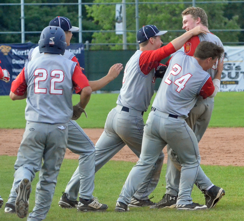 . KYLE MENNIG � ONEIDA DAILY DISPATCH Sherrill Post\'s Davey Moffett is mobbed by his teammates after his game-winning hit against Binghamton Post during their American Legion Baseball State Championship tournament game in Utica on Tuesday, July 25, 2017.