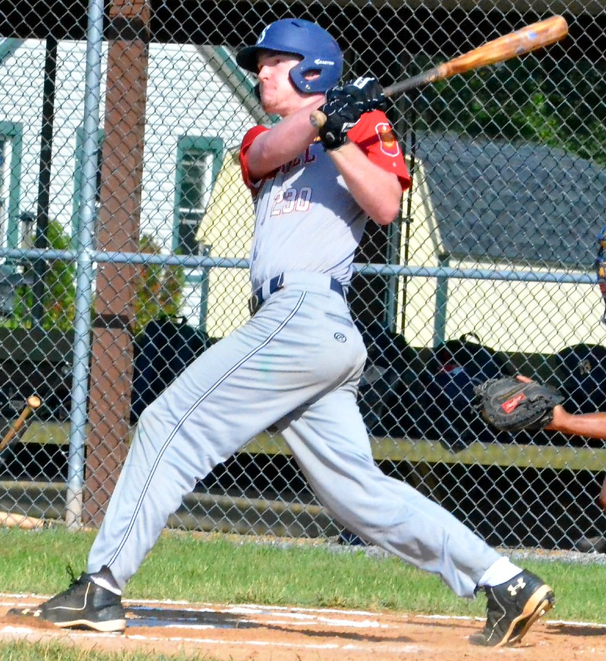 KYLE MENNIG – ONEIDA DAILY DISPATCH Sherrill Post's Davey Moffett follows through on his swing after hitting an RBI single against Ilion Post during their game in Sherrill on Sunday, July 16, 2017.