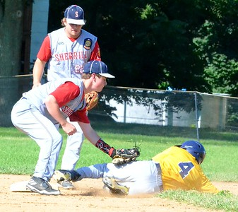 KYLE MENNIG - ONEIDA DAILY DISPATCH Ilion Post's Evan Dunning (4) slides into second as Sherrill Post's Blake VanDreason (3) makes the tag during the first inning of their game in Sherrill on Sunday, July 16, 2017. Dunning was called safe on the play.