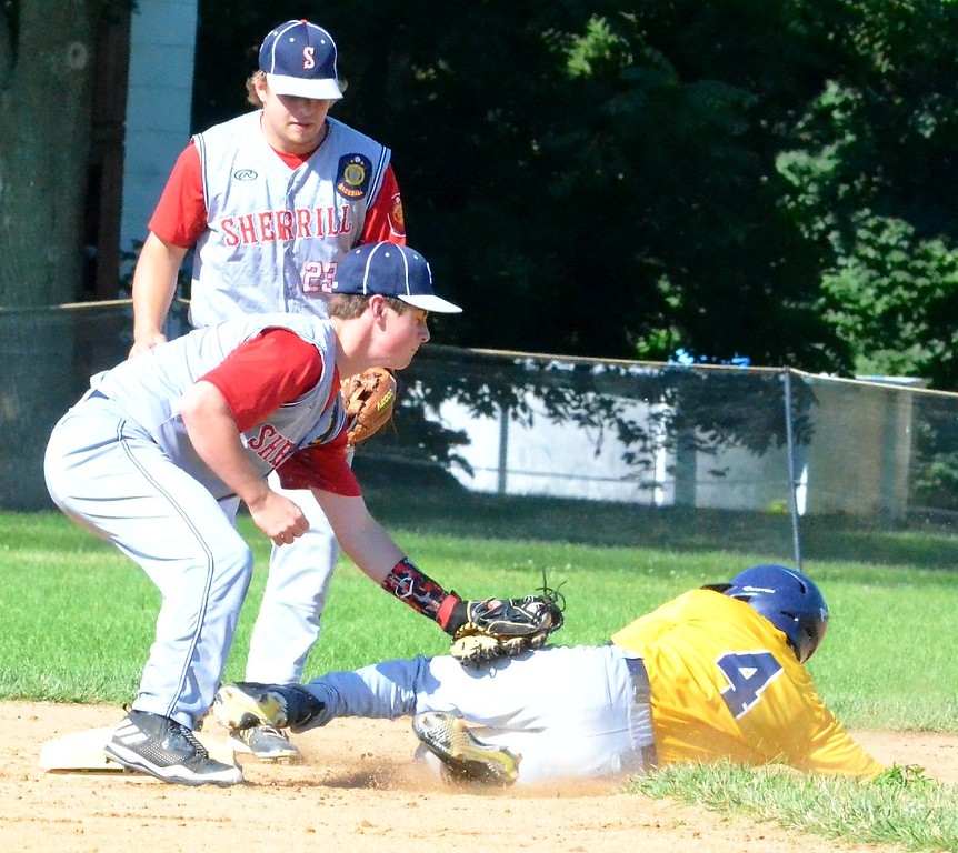 . KYLE MENNIG - ONEIDA DAILY DISPATCH Ilion Post�s Evan Dunning (4) slides into second as Sherrill Post�s Blake VanDreason (3) makes the tag during the first inning of their game in Sherrill on Sunday, July 16, 2017. Dunning was called safe on the play.