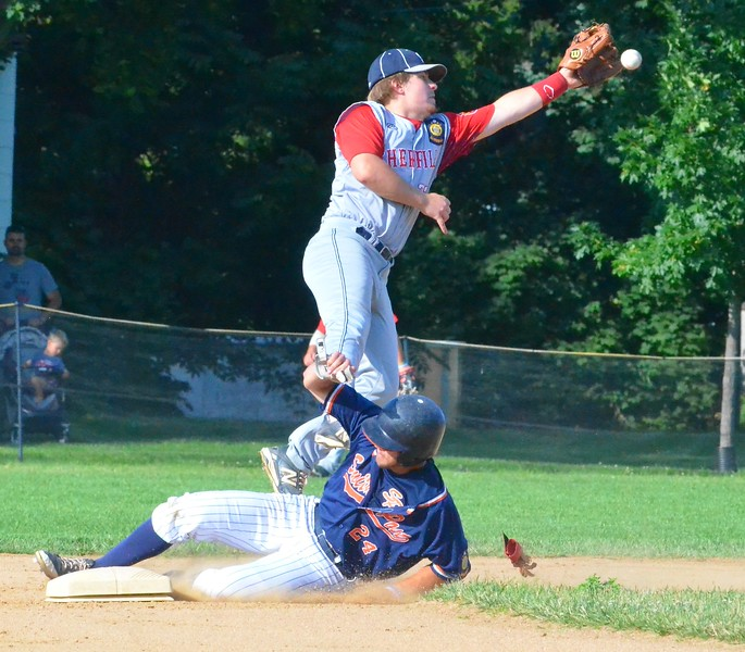 KYLE MENNIG – ONEIDA DAILY DISPATCH Sherrill Post's Dylan Shlotzhauer (1) jumps to catch a throw as Smith Post's Derrick Miller (8) slides safely into second for a stolen base during their American Legion Baseball District 5 playoff game in Sherrill on Tuesday, July 18, 2017.