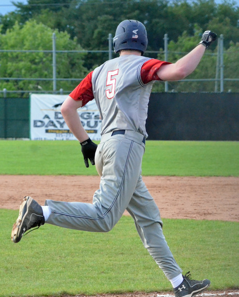 KYLE MENNIG – ONEIDA DAILY DISPATCH Sherrill Post's Davey Moffett watches his game-winning hit against Binghamton Post during their American Legion Baseball State Championship tournament game in Utica on Tuesday, July 25, 2017.