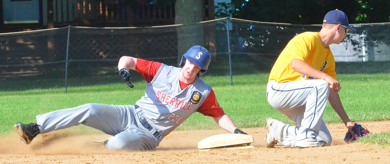 KYLE MENNIG – ONEIDA DAILY DISPATCH Sherrill Post's Davey Moffett (5) slides safely into second for a stolen base as Ilion Post's A.J. Rathbun fields the throw during their game in Sherrill on Sunday, July 16, 2017.