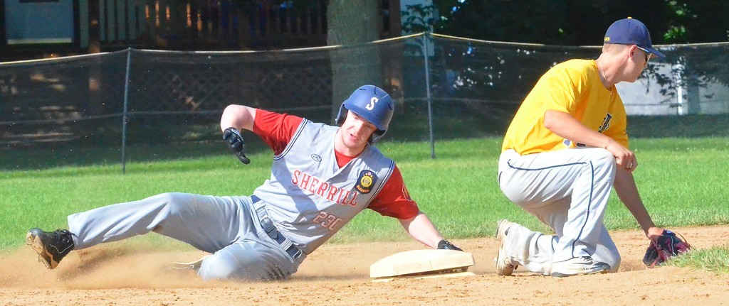 . KYLE MENNIG � ONEIDA DAILY DISPATCH Sherrill Post�s Davey Moffett (5) slides safely into second for a stolen base as Ilion Post\'s A.J. Rathbun fields the throw during their game in Sherrill on Sunday, July 16, 2017.