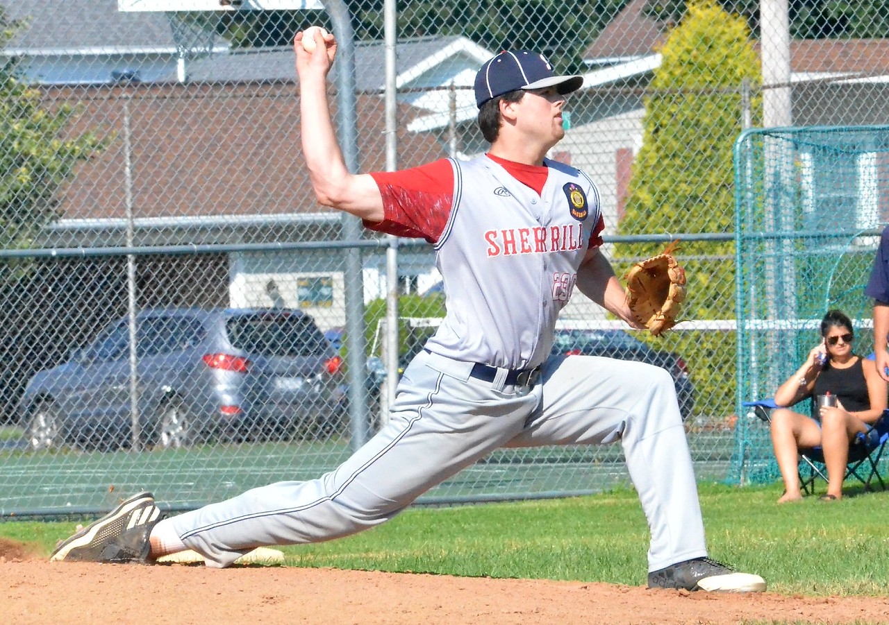 KYLE MENNIG – ONEIDA DAILY DISPATCH Sherrill Post's Andrew Roden delivers a pitch to a Smith Post batter during their American Legion Baseball District 5 playoff game in Sherrill on Tuesday, July 18, 2017.