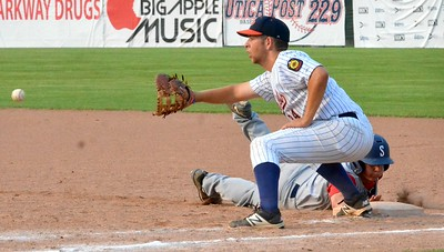 KYLE MENNIG – ONEIDA DAILY DISPATCH Sherrill Post's Ryan Palmer (9) dives back into first ahead of a Smith Post pickoff throw during their American Legion Baseball District 5 playoff game in Utica on Friday.
