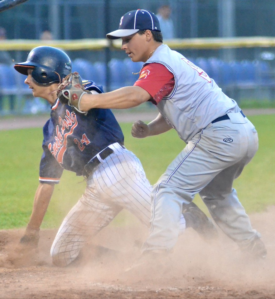 KYLE MENNIG – ONEIDA DAILY DISPATCH Smith Post's Cole Donnelly, left, is safe at home after sliding in under the tag of Sherrill Post's Ryan Palmer during their American Legion Baseball District 5 playoff game in Utica on Friday, July 21, 2017.