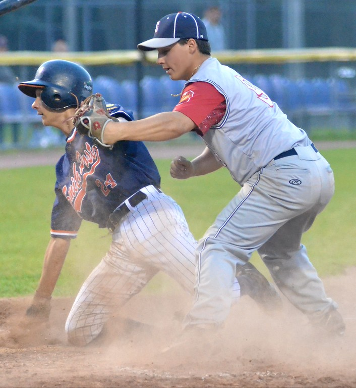 . KYLE MENNIG � ONEIDA DAILY DISPATCH Smith Post\'s Cole Donnelly, left, is safe at home after sliding in under the tag of Sherrill Post\'s Ryan Palmer during their American Legion Baseball District 5 playoff game in Utica on Friday, July 21, 2017.