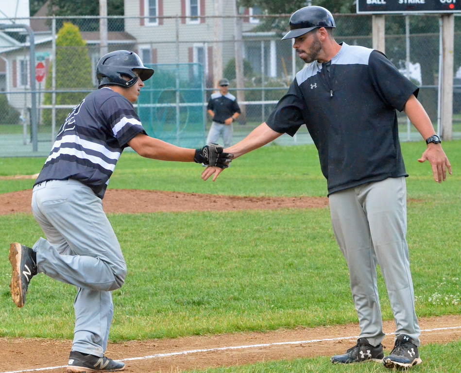 . KYLE MENNIG � ONEIDA DAILY DISPATCH Sherrill Silversmiths catcher Vincent Timpanelli, left, is congratulated by manager Jimmy Hegmann after hitting a home run against the Cortland Crush during their game in Sherrill on Saturday, July 15, 2017.